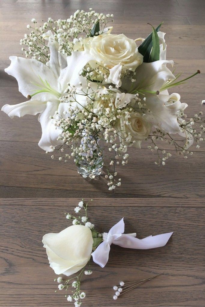 A beautiful white bouquet with lilies, roses and ...