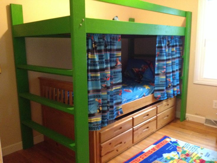We built this loft for our grandsons fr free plans online so they could have more space to climb and play! It fit right over their Trundle bed. The boys picked the color, and we painted the underside navy blue and added glow- in- the-dark stars. The curtains were made from a twin Mario sheet hung on 3/8 inch PVC pipe and attached with brackets.