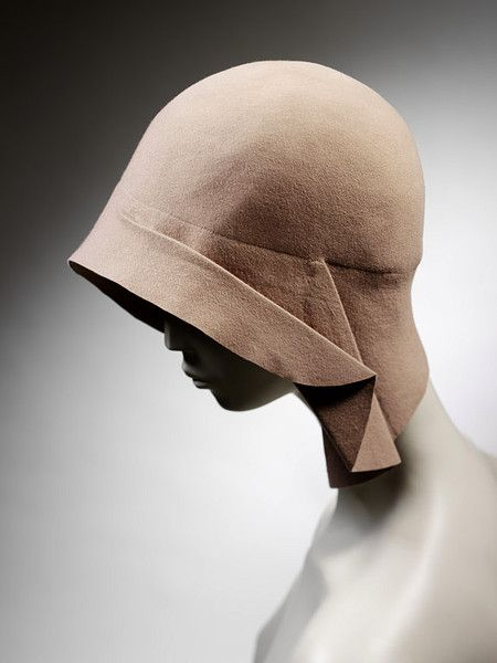 Lanvin cloche 1928-29...The Iconic Cloche Hats of the 1920s/Art Deco influence can be seen in the zigzag seaming and construction lines of many cloche hats. Art Deco appliqué was a popular embellishment. Cloches existed in many forms including one with a beret like top.