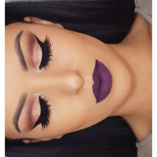 Want this look! Lovin tge soft cut crease winged eyes with the dramatic purple lippy