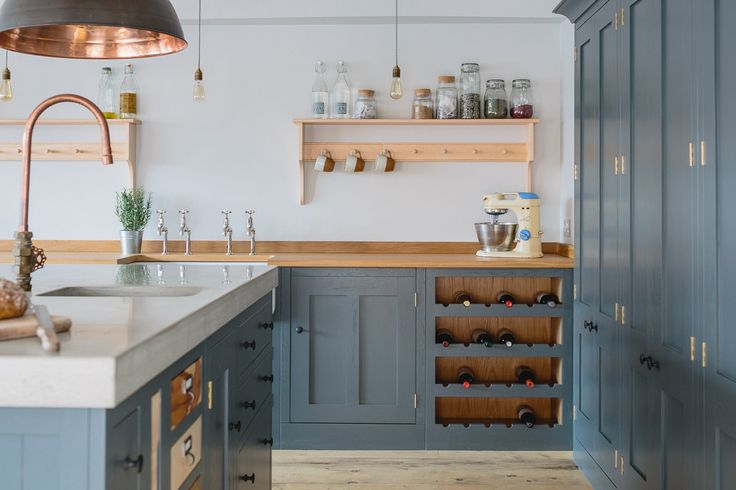 Sustainable Kitchens Showroom. Farrow & Ball Down Pipe for the island, cabinets, and larder contrast beautifully with the concrete and oak worktops. Industrial elements include bespoke copper tap, hanging pendant lights from Original BTC.