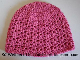 A sweet lace hat made to match the V-Stitch Fingerless Gloves by Daphne Bekiari.