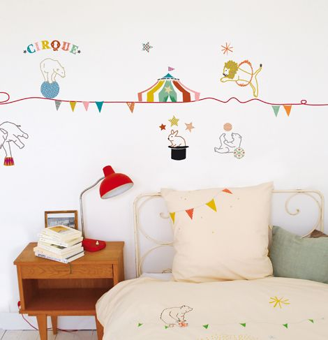 Wall decals too often look like a haphazard after-thought, but the way these tie into the bedding plus the fact that they're so freaking adorable elevates this room to super awesomeness.