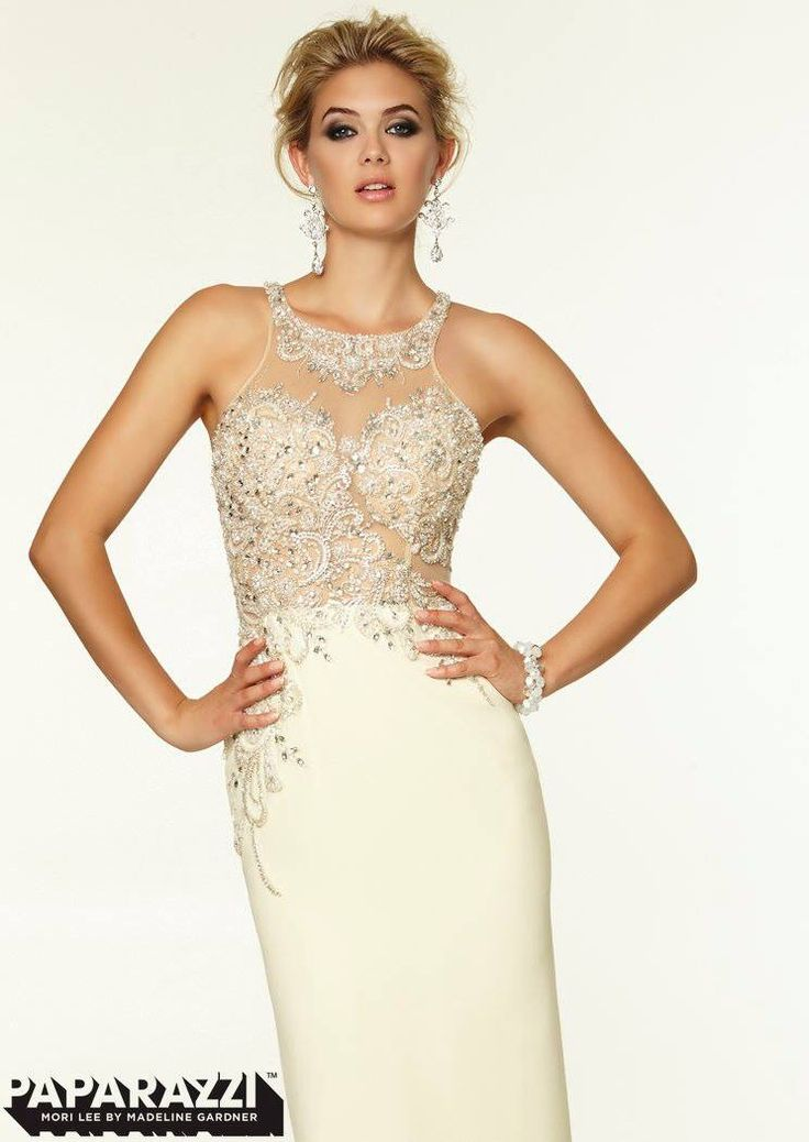 This dress is beautiful. The beading detail is amazing. It's a good mix of sexy and still classy. Click the link to learn more.   Image Credit: Bridal Warehouse Facebook