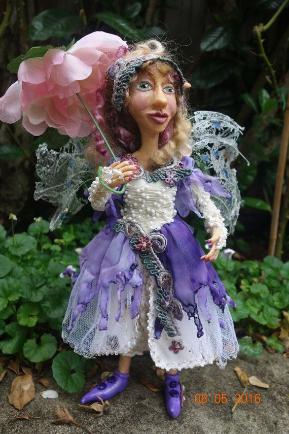 OONA- One Of A Kind - FAIRY/Elf, Polymer Clay-One Of A Kind art doll. 12 (30 cm) Tall Oona is signed by myself, the artist on the back of her neck. Oona is cheerful and friendly Elfin Girl, she lives in gardens and parks where roses, camellias and violets grow. She brings peace and