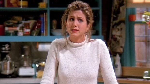 We're thinking that tied-back hair is in the classic 'Rachel' cut.