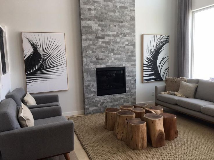 Take a look at this beautiful scandinavian look living room featuring our Persia light Hickory hardwood floor. This beautiful floor from our Émira series features our Pure Genius air-purifying technology. Photos taken in on of Homes by Avi show home, decorated by Show Home Girls. #artfromnature
