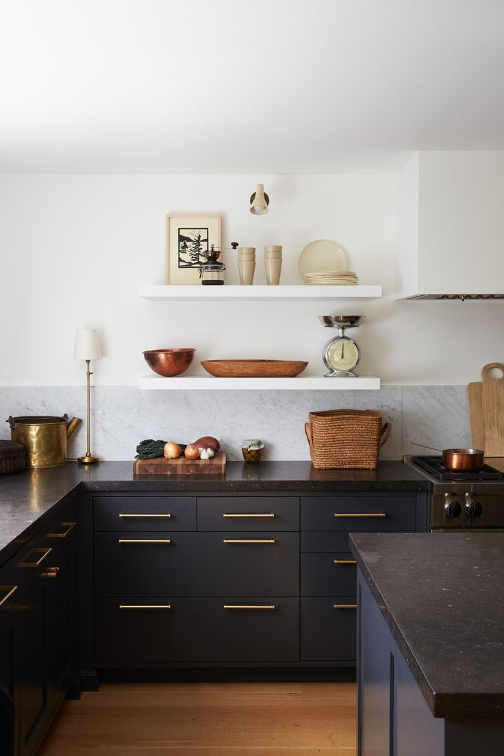 Black Base Cabinets With White Floating Shelves Above Brass