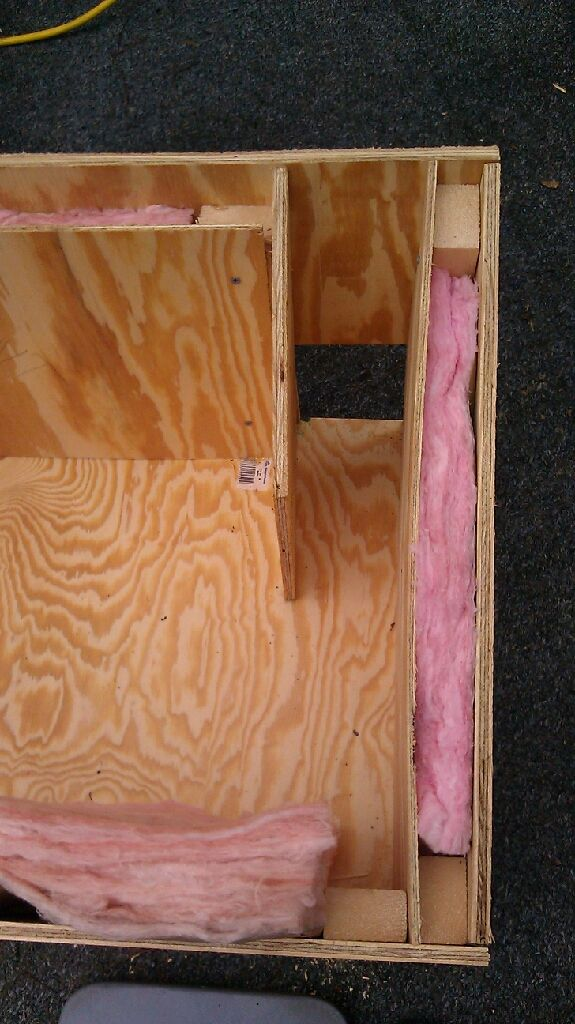 Inside of feral cat house, double wall lined with  insulation, we add tiles to floor, and then fresh straw inside . As the cat enters there is a wind break. you can buy tile flooring with sticky back at home depot.