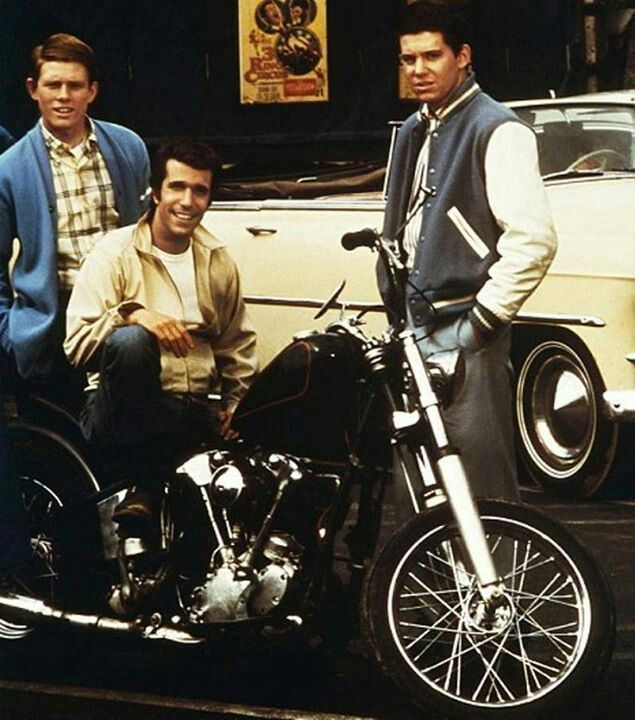 ((The Fonz (Henry Winkler) changed from a Triumph to a HD Knucklehead mid series 'Happy Days' - for more 'street cred'...)) OOPS! that was my impression NOT the facts!! - The ORIGINAL bike was the chopped Knucklehead but that bike was too much for Henry to handle, so they got him the smaller Triumph, he could sit on and push since he could not ride at all. He has tried but his dyslexia is SO bad he can't process how to operate the brake, clutch and gears. All shots of him riding are staged.