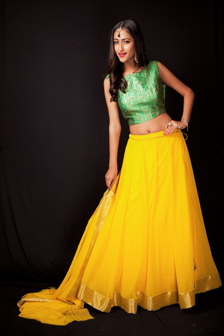 This Yellow lehenga with green crop top brings out the sparkle in you and yet keep your look elegant !! #Yellow #brightcolor #Bridesmaid #Friendsofthebride #Lehenga #wedings #brides #Sparkle #RentAnAttire #Differentisbeautiful