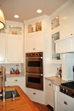 Cooktop separate from wall oven... cabinet below? Or washer/dryer below the oven? Wall Oven Design Ideas, Pictures, Remodel, and Decor