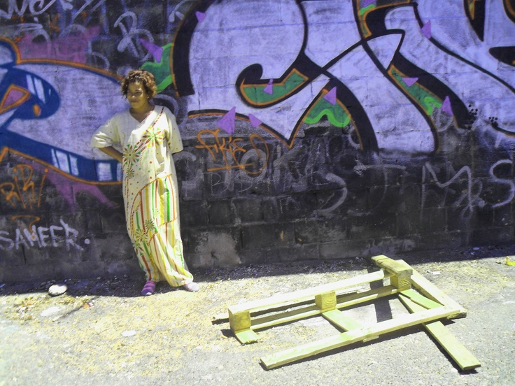 This woman proudly showed us her name on the street art wall in her neighbourhood - Woodstock