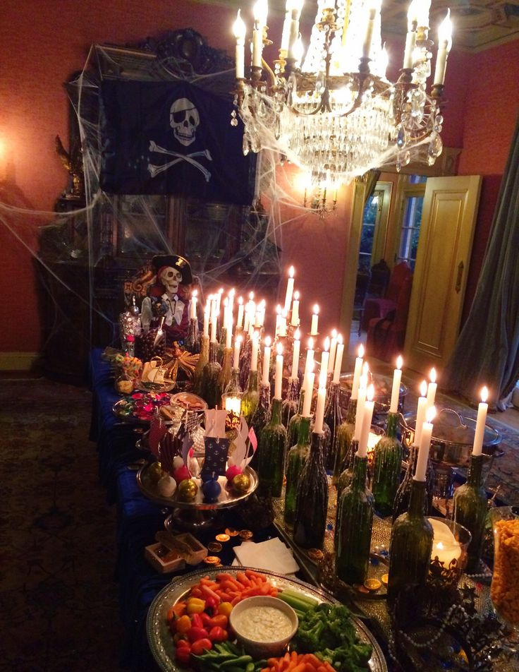 CAPTAIN HOOKS FEAST! Pirate Party food, Pirate party dinning room table, Pirate Party sweets, pirate cookies, pirate party, halloween party, candy bar, pirate desserts, hidden treasure, fun, party, jewels, halloween, skeleton, black flag, halloween