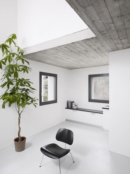 loft. board-formed concrete which leaves the cool wood impression. fantastic way to open up the house's tiny 400 sq. ft. footprint.