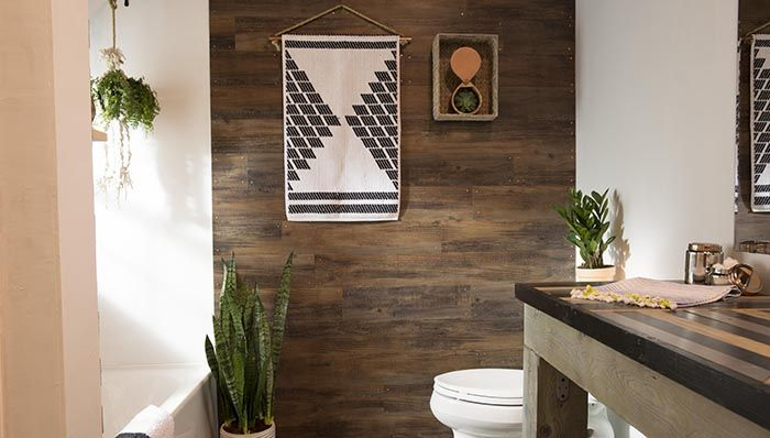 plank accent wall. Uses vinyl peel and stick flooring and copper nails. Really love the look for such a low cost and easy DIY.
