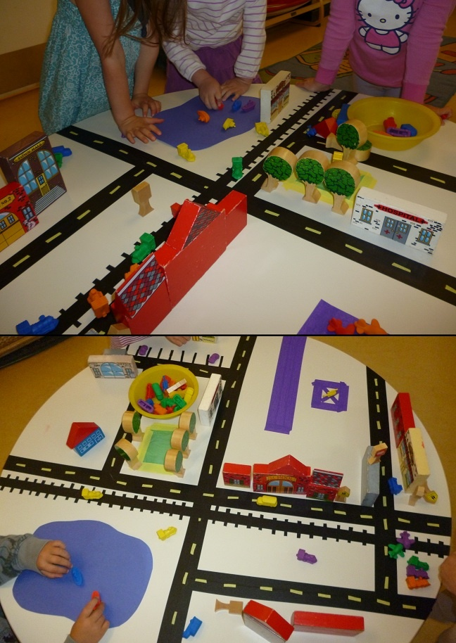 My kids worked on this table city all week! I made masking tape roads and the kids helped develop the city from there. Every time one had an idea we added to the city. Including a train track that runs around the table on the floor. :)
