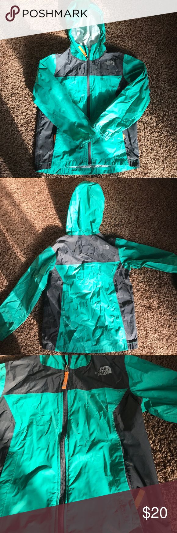 Kids North Face rain jacket size small 7/8 This is a North Face kids rain jacket. Minor signs of use but lamination excellent. Ready for fun on a new kid 😊 The color would be suitable for a boy or girl. The North Face Jackets & Coats Raincoats
