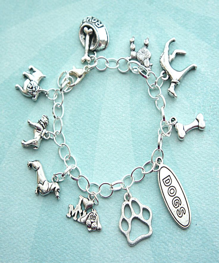 this charm bracelet features dog lover inspired Tibetan silver charms (nickel free). the charms are attached to a silver tone chain bracelet that measures 7.5 inches in length.