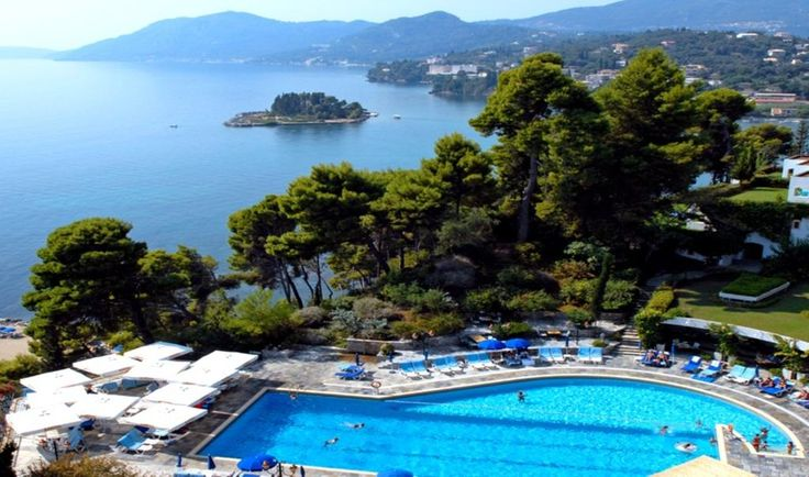 Corfu Holiday Palace || Overlooking the sea, a lagoon and the famous Pontikonissi, this holiday resort is close to Corfu's town centre. It offers private access by cableway to the sandy beach, and indoor and outdoor pools.