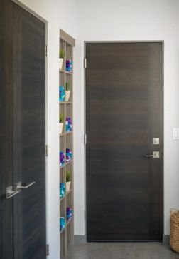 For a more modern, minimalist, and sleek look, a flush door (with a flat surface) is the way to go. Flush doors work well in rooms with other flat cabinetry, can be customized with specialty finishes, and are easier to clean than panel doors.