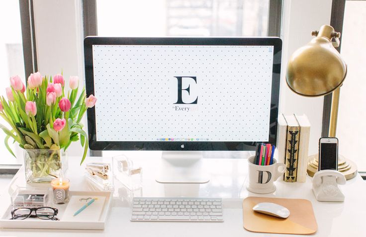 @Danielle Lampert Moss of The Everygirl // office space // large windows // white parsons desk from @Elise West elm // fresh flowers // gold lamp // @Anthropologie mug // @Jonathan Nafarrete Adler docking station // photography by Stoffer Photography