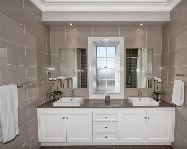 #CamelotHomes | Wilton Project Caesarstone vanity with white cabinets and drawers.