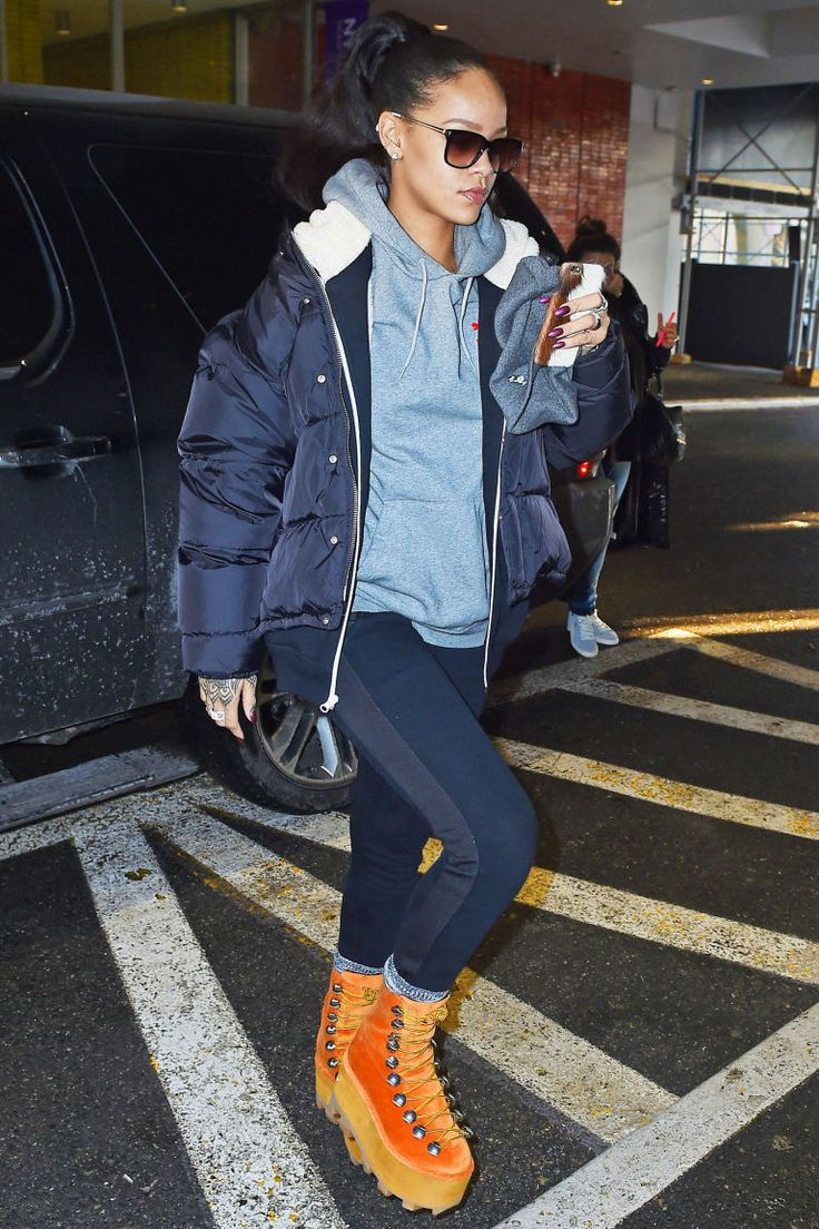 Rihanna is seen out and about with Alexander Wang's lace-up's straight from the runway.