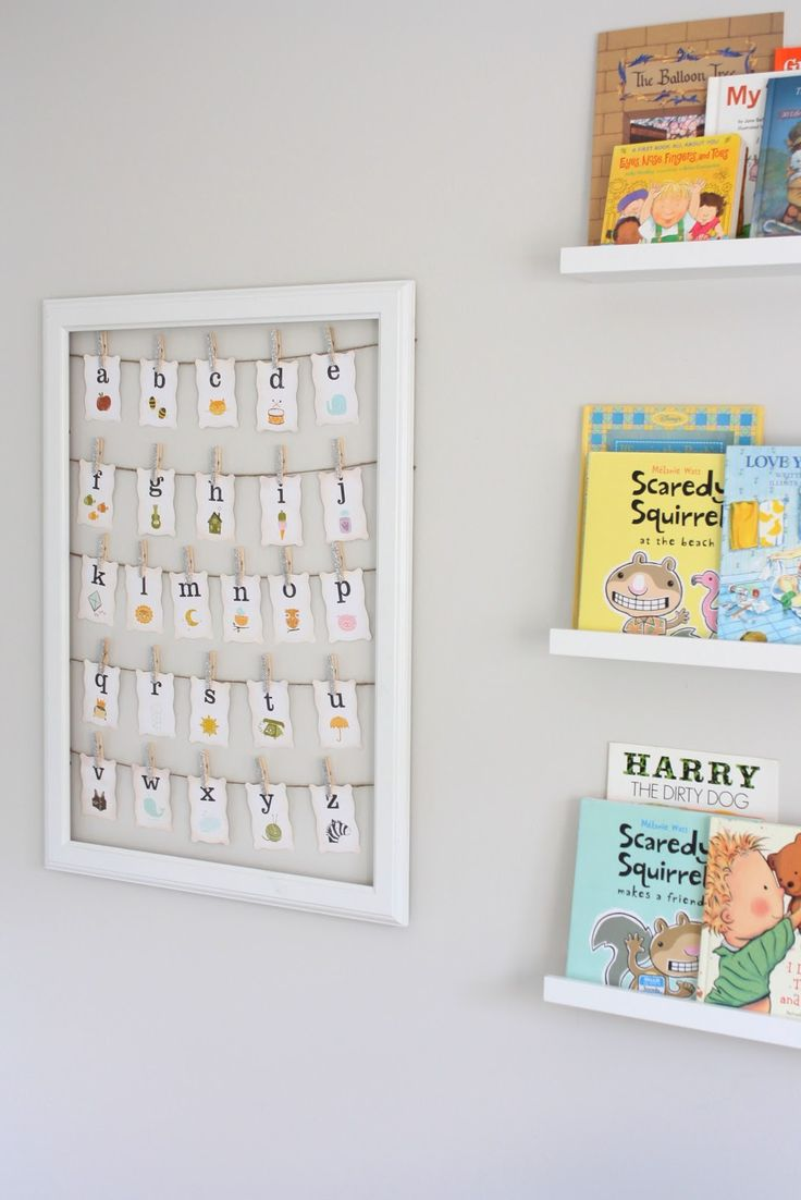 Cute ideas for nursery walls...love the book display and framed alphabet letters.