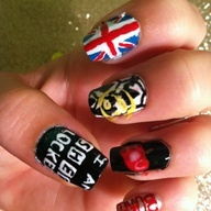 This is my right hand for my Sherlock nails. The thumb is I AM SHER LOCKED the pointer is the union jack. The middle finger is the wallpaper in his flat with the smiley he shot into the wall. My ring finger is Moriaritys IOU apple and the pinky says BORED. (all my nails designs are original. If not I will give credit.)