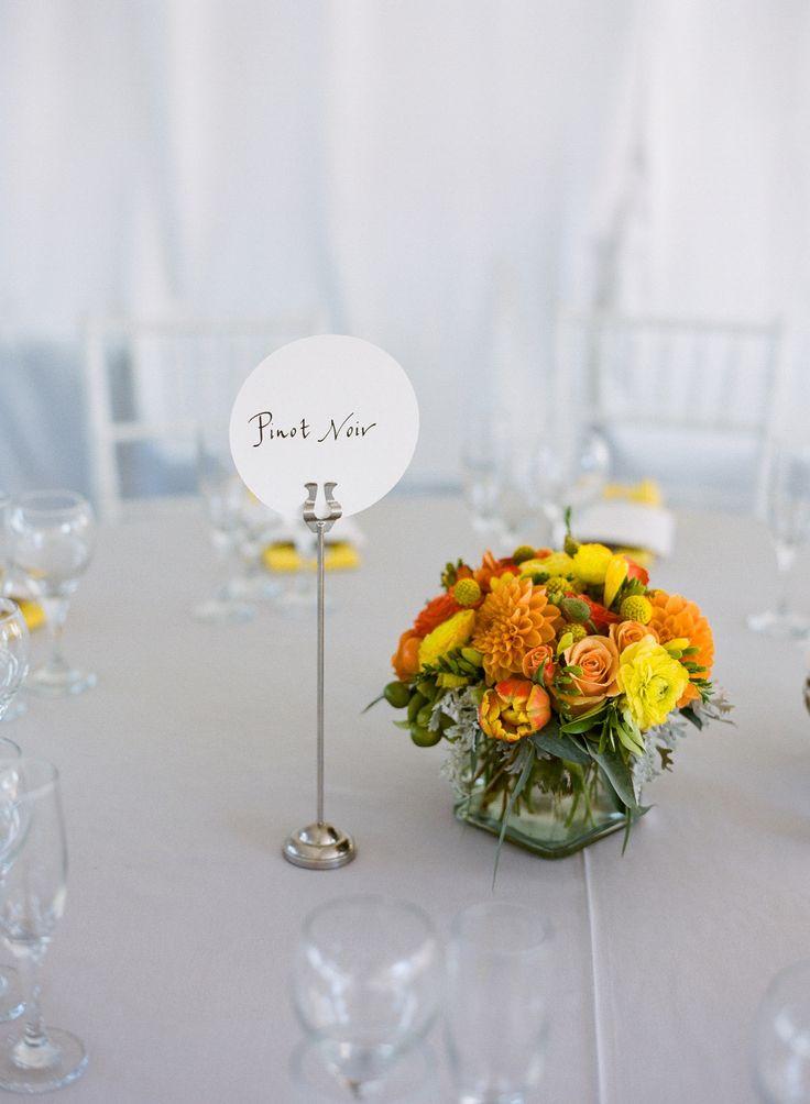 #vineyard, #table-names  Photography: Em The Gem - emthegem.com  Read More: http://www.stylemepretty.com/2014/07/30/classic-vineyard-wedding-with-a-pop-of-color/