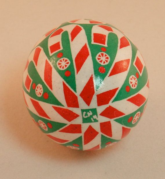 It doesnt get any sweeter than this original design inspired by candy canes and starlight mints in red and white stripes on a vibrant green background done in batik dye and wax-resist style on a real chicken egg shell. Contents removed through a single hole on the top, capped with a gold