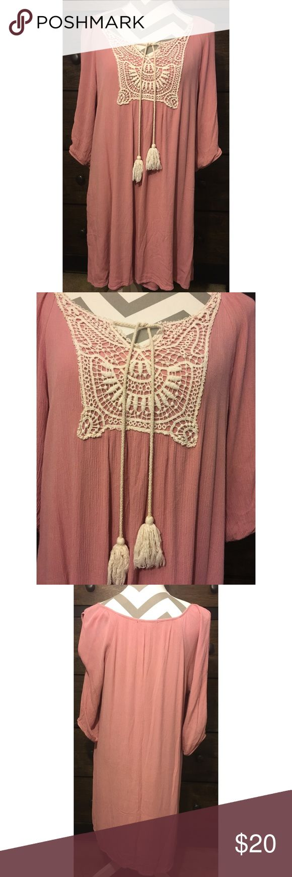 Naif Blush Pink Boho Dress Gently used dress. Crochet and tassel detail at neckline. 3/4 sleeves with cut out detail. Size medium. 100% Rayon naif Dre…