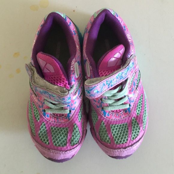 Used ASICS girls tennis shoes Used ASICS GEL NOOSA  TRI 10 girl tennis shoes size 11. The colors are purple, teal, sky blue and pink. I love the colors, but my daughter has outgrown the shoes. There is a Velcro strap across the top. asics Shoes Athletic Shoes