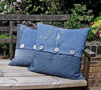 Old denim jeans made into pillows. I'm thinkin i love this for my porch this summer, with a splash of red!