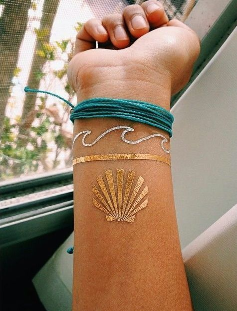 25 best ideas about gold tattoo on pinterest flash for Metallic tattoo ink