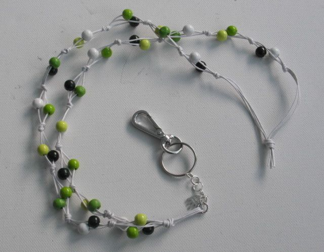 Avainnauha #11 by Miss Piggy / Key chain, ID holder. Made with wooden beads and waxed cord.