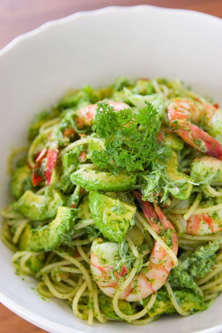 Savory shrimp, creamy avocado, and the bright green flavors of the pesto make for a balanced combination of flavors and textures in this easy pasta dish.