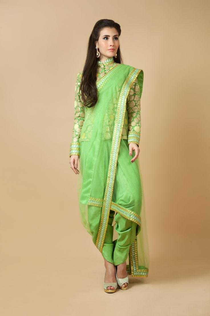Crepe dhoti saree with raw silk blouse embellished with zari, thread and gota work. Item number W15-126