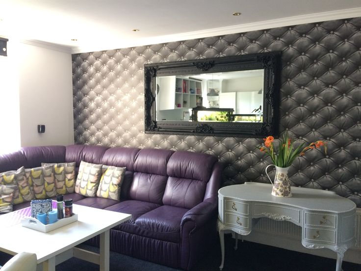 Our living room with leather effect wallpaper and leather made to order purple corner sofa bed