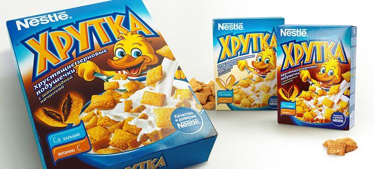 Дизайн упаковки бренда «Хрутка», создание бренд-персонажа и предпечатная подготовка.Под торговой маркой «Хрутка»выпускаютсяготовые завтраки, разработанные компанией Nestleспециально для российского рынка.