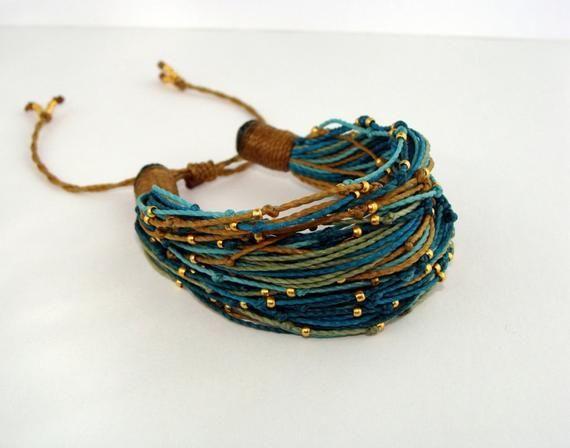 Items similar to Multi Strand Spring Bracelet Turquoise Mustard on Etsy