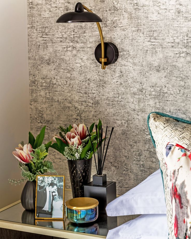 This vinyl Cerano Slate wallpaper by Designers Guild adds a beautiful, organic feel and rich texture to the bedroom design in our latest London project, brought to life by the verdant bedside florals.