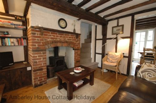 North Walls Cottage | Sleeps 4 | Chichester. Within the Chichester city walls, this charming Grade II listed terraced cottage makes the perfect city break. Enjoy a relaxing city break in this charming cottage in the heart of Chichester with lots of character and a woodburning stove.