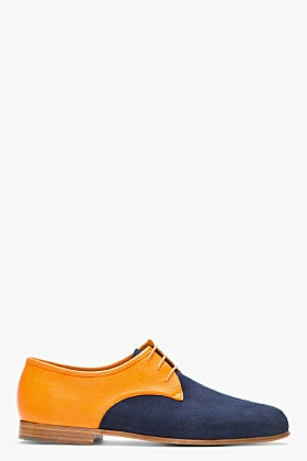 CARVEN Orange & Navy Two-Tone Leather Derbys -  Low top suede derbys in navy. Round toe. Orange lace up closure. Contrast leather paneling in orange. Tan foxing. Tone on tone stitching.     Part of the Zespà for Carven capsule collection.    Leather upper, leather/rubber sole. Made in France.