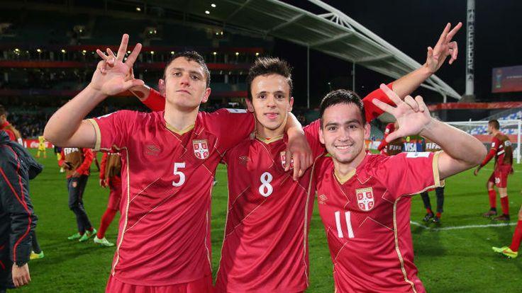 Milos Veljkovic, Nemanja Maksimovic and Andrija Zivkovic of Serbia celebrate.