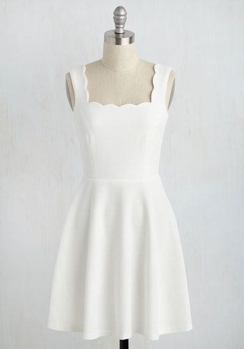 Celebrate your successes in the subtle elegance of this white dress, and show off your achievements in more than one way! This classic A-line is styled up with a scalloped, square neckline, flattering princess seams, and a textured knit, offering a look that matches your academic efforts in impressiveness.