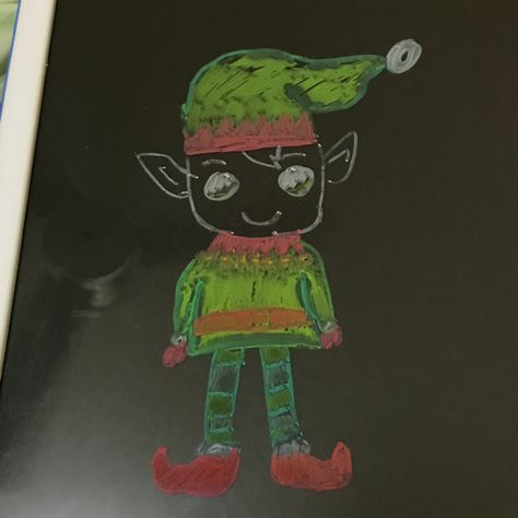 This elf is drawn on a white board that glows with whiteboard pens
