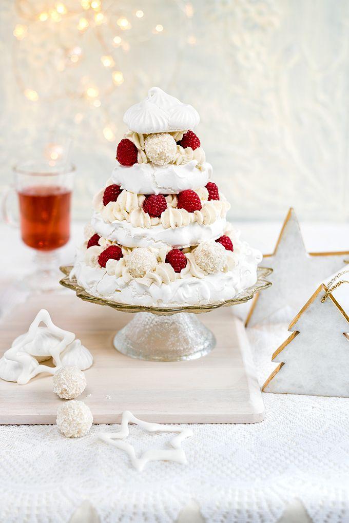 Meringue Christmas tree with whipped coconut cream, raspberries and white chocolate truffles