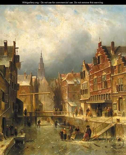 A townview in winter with figures on a frozen canal - Charles Henri Leickert